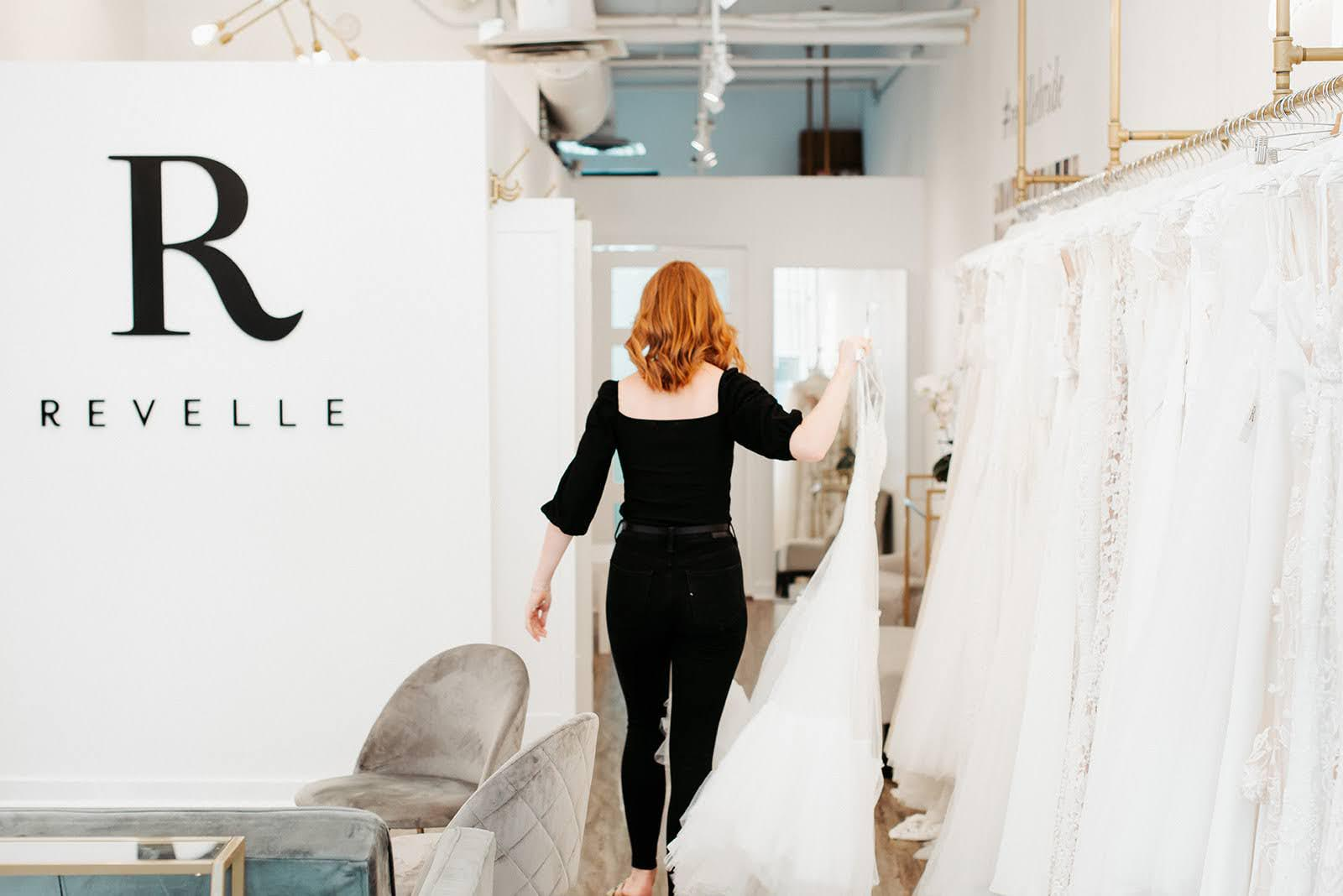 Revelle Bridal - Sacha carrying gown - Photo Credit Laura Kelly Photography